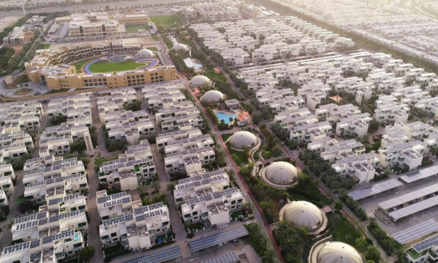 The Sustainable City in Dubai aims to become Net Zero Energy, featuring community farms and solar power.